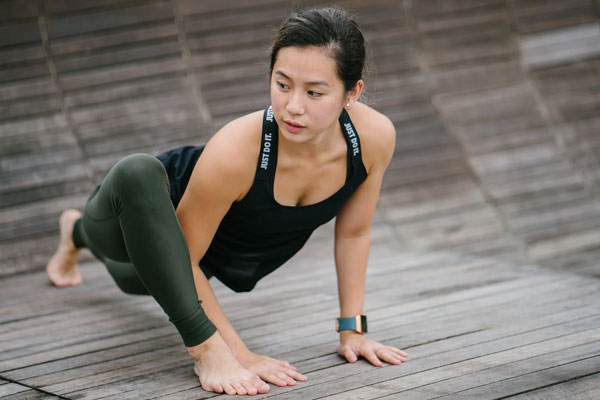athletic woman doing stretches